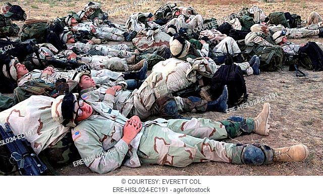 U.S. Soldiers of the 10th Mountain Division sleep in an open field after their first day in Uzbekistan where U.S. soldiers are grouping less than one month...