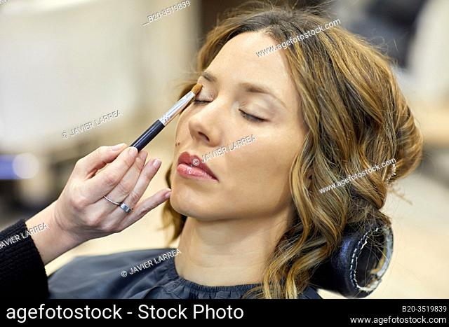 Make-up artist putting on a woman's face, hairdressing salon and beauty clinic