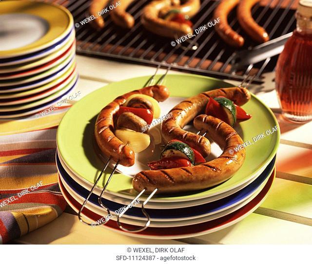Sausages and vegetables on kebab sticks