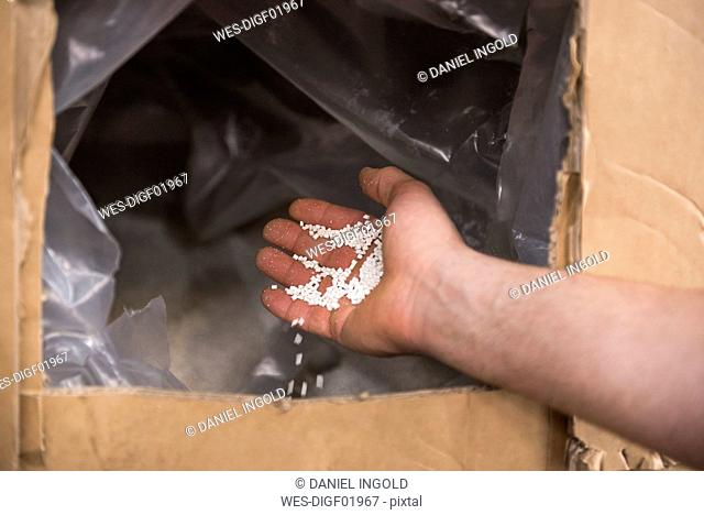 Close-up of hand with packing material
