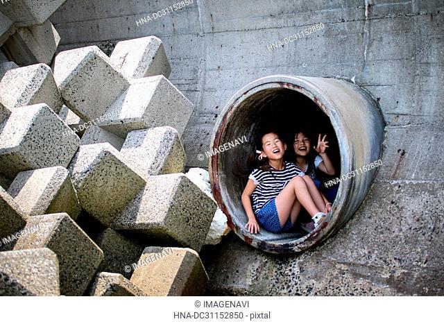 Girls Peeping through Hole
