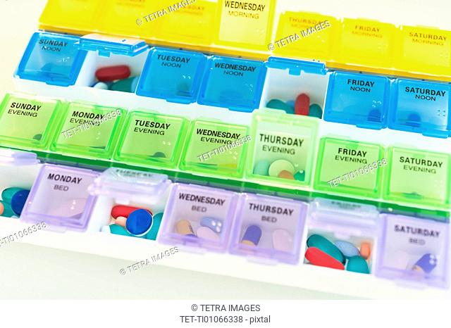 Studio shot of colorful pill containers