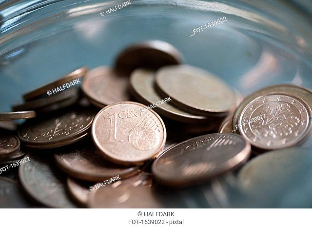 Close-up of Euro cent coins in glass jar