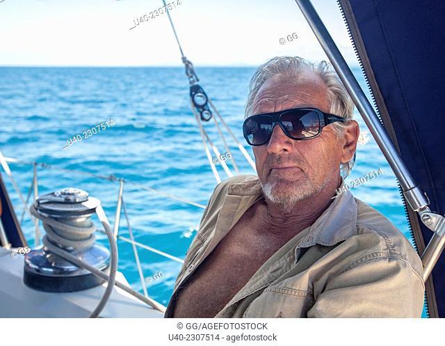 Belize, Captain in cockpit of sailboat