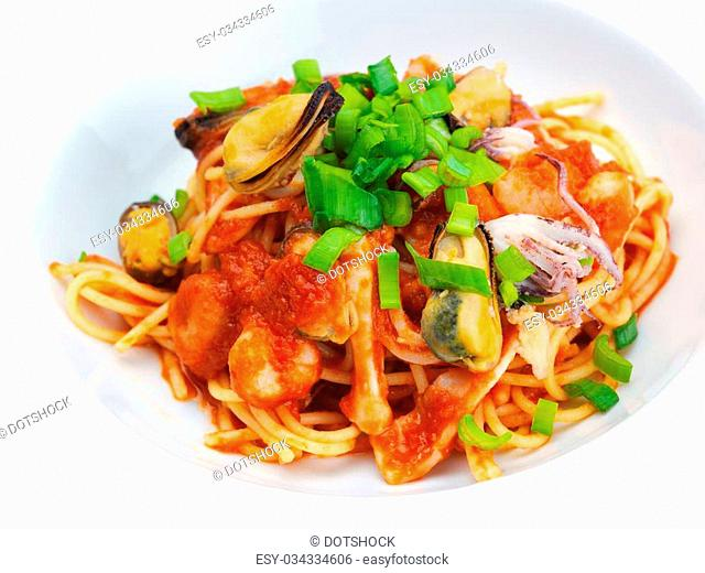 Pasta food with shrimps, herbs and mashrooms isolated on white background in studio