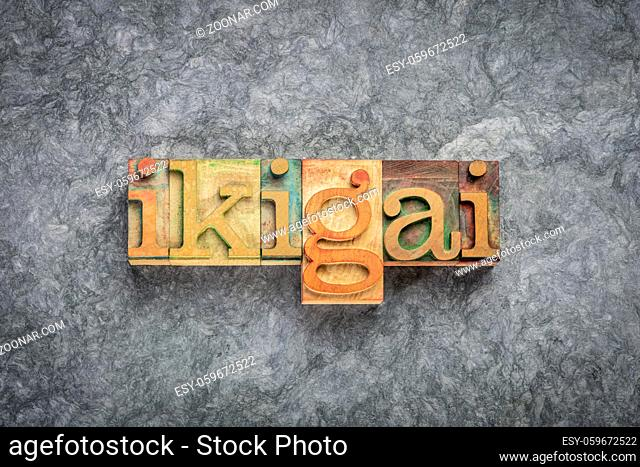 ikigai - Japanese concept of a reason for being, life purpose or a reason to wake up - word in vintage letterpress wood type against textured handmade paper