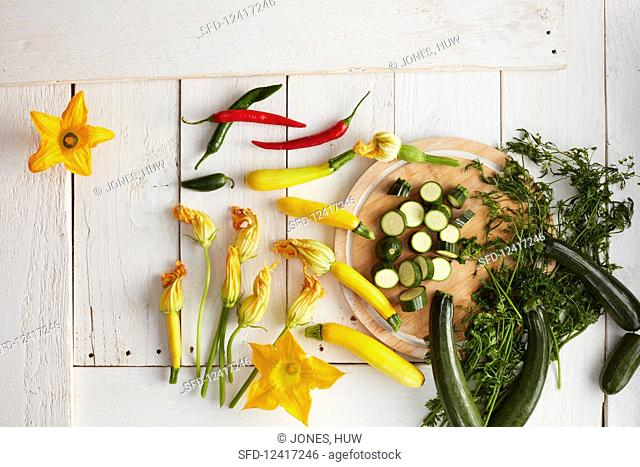 Fresh zucchini, zucchini flowers and chili peppers