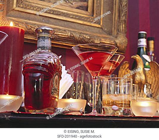Several drinks & whisky bottle in stylish setting (1)
