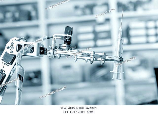 Robotic hand holding syringe