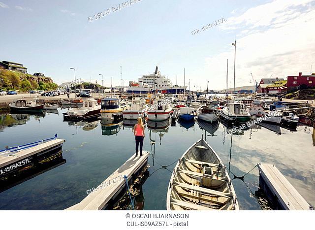 Woman on harbour pier, Torshavn, Faroe Islands