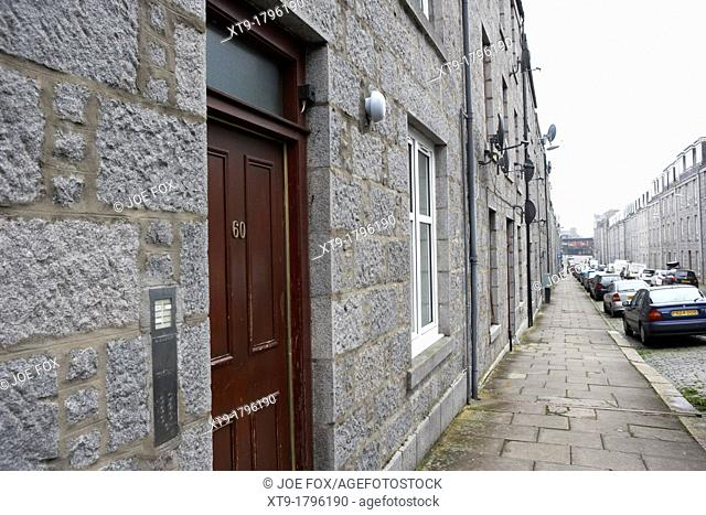 rows of granite terraced tenement houses aberdeen scotland uk