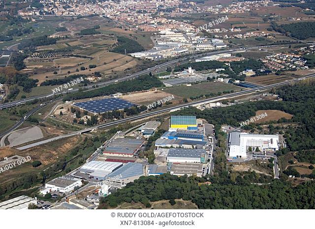 Spain, Catalonia, Barcelona, Barcelonés, industrial area in Santa Agnès de Malanyanes, AP-7 freeway in background, AVE (high speed train) course to Girona under...