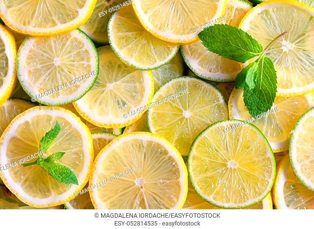 Fresh green and yellow lemon slices background