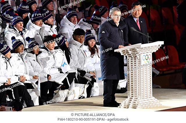 Thomas Bach (l), the German president of the International Olympic Committee (IOC) speaks at the opening ceremony of the Winter Olympics in Pyeongchang