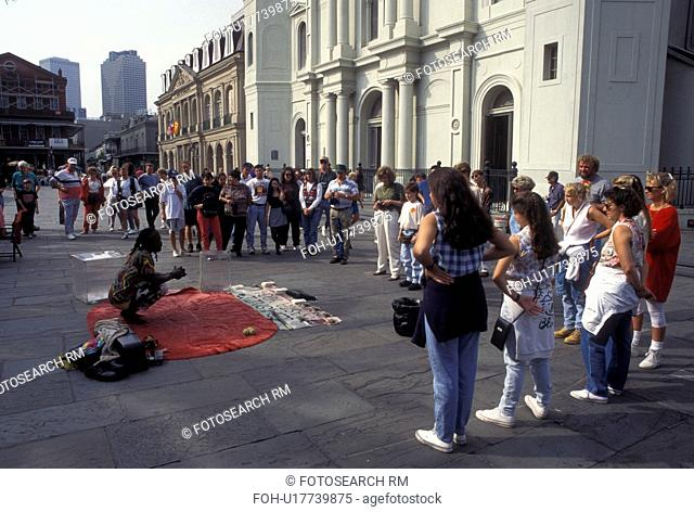 New Orleans, LA, French Quarter, St. Louis Cathedral, Louisiana, Street artist entertains a crowd of people outside the Saint Louis Cathedral at Jackson Square...
