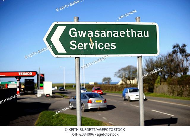Bilingual sign in Welsh and English, advertising services at a petrol station, Llanrhystud, Wales, UK