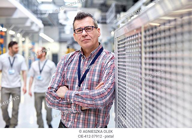Portrait confident male supervisor in factory