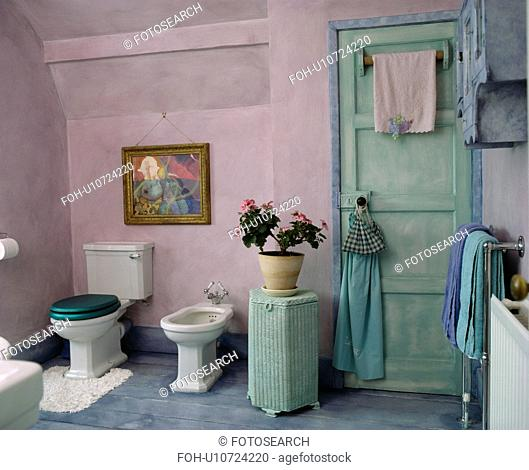 Turquoise door and cabinet in mauve country bathroom
