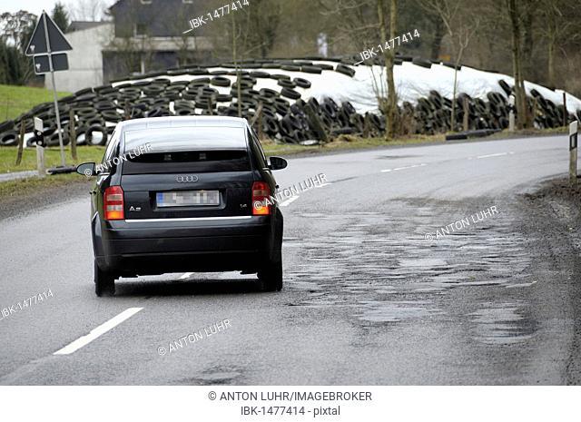 Car avoiding potholes, road damage on the L286, North Rhine-Westphalia, Germany, Europe