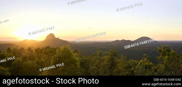 Panorama of sun rising over Glasshouse Mountains on the Sunshine Coast