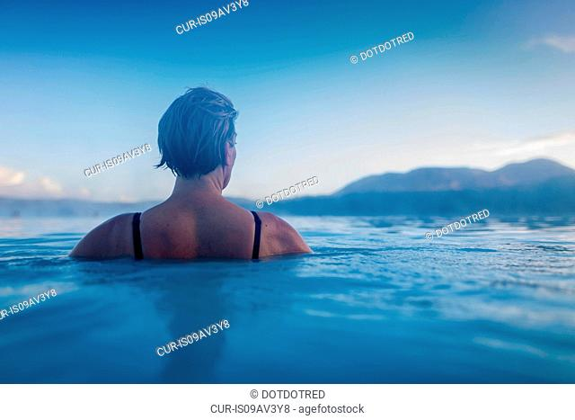 Backview of woman in lagoon waters