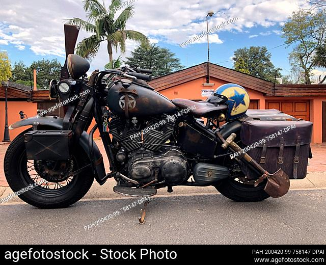 08 March 2020, South Africa, Johannesburg: Eye-catchers like this Harley-Davidson are no rarity in front of the garage of South African oldie fan L