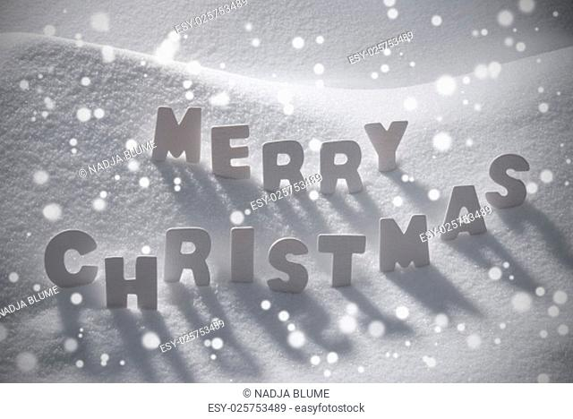 White Wooden Letters Building English Word Merry Christmas. Snow And Snowy Scenery With Snowfalkes. Christmas Atmosphere