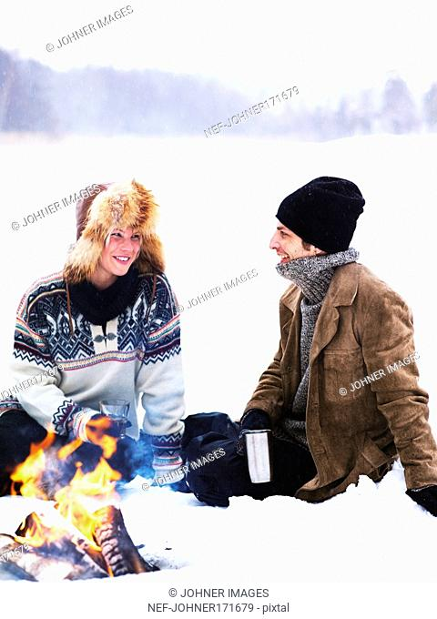 A man and a woman on a winter picnic