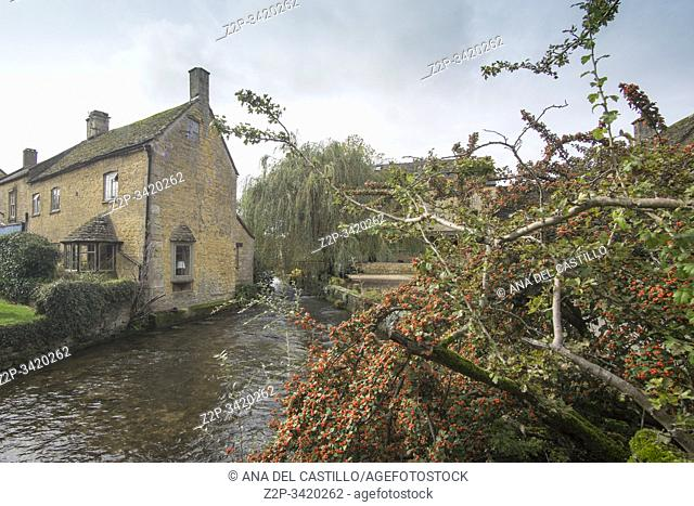 COTSWOLDS ENGLAND UK ON OCTOBER 12, 2019: One of the most beautiful villages in the Cotswolds Bourton-on-the-Water. View along the river Windrush