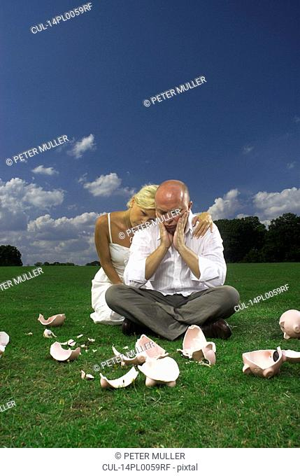 couple and smashed piggy banks