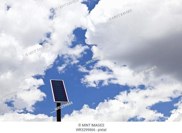 Solar Panel Under a Cloudy Sky