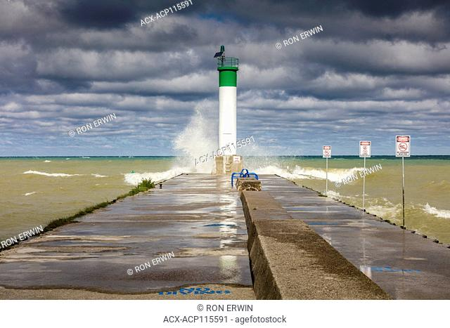 Waves hitting the pier at the mouth of Parkhill Creek at Lake Huron in Grand Bend, Ontario, Canada