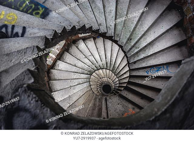 Curved stairs in a tower of Unfinished castle - unofficial tourist attraction in Lapalice village, Kashubia, Poland. Building of castle began in 1979