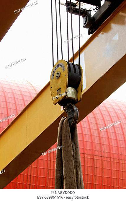 industrial crane hook with wire rope holding the load