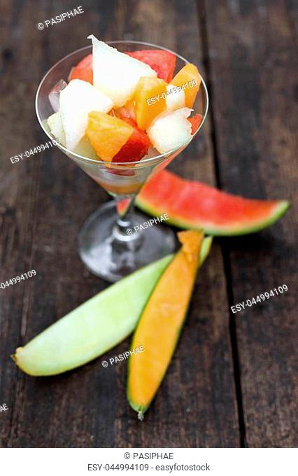 topview of an fruit salad with various melon slices
