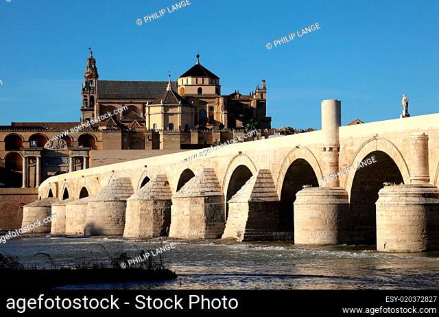 Roman Bridge with the Cathedral-Mosque of Cordoba in the background. Andalusia