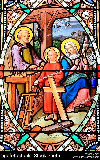 Jesus Christ, carpenter. Stained glass window. Our Lady of La Salette. La Salette-Fallavaux. Isere. Auvergne Rhône-Alpes. France. Europe