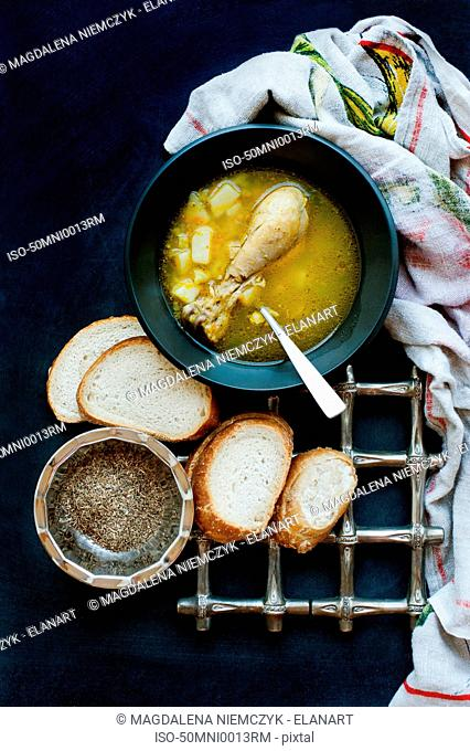Bowl of soup with bread and pepper