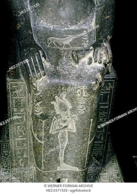Seated statue of the Princess Shebensopdet, granddaughter of Osorkon II. A sistrum-player of Amun, this statue was commissioned and placed in the temple of Amun...
