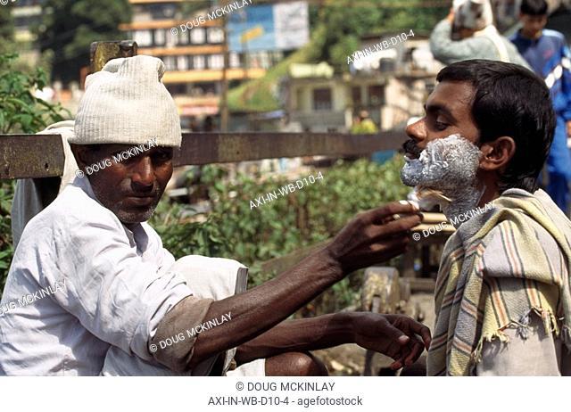 Streetside shave , Darjeeling, India