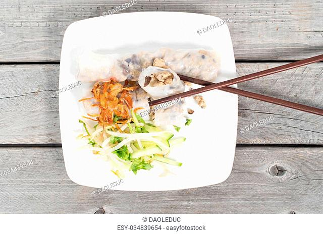 Banh cuon, Vietnamese steamed rice noodle rolls on a wooden table background