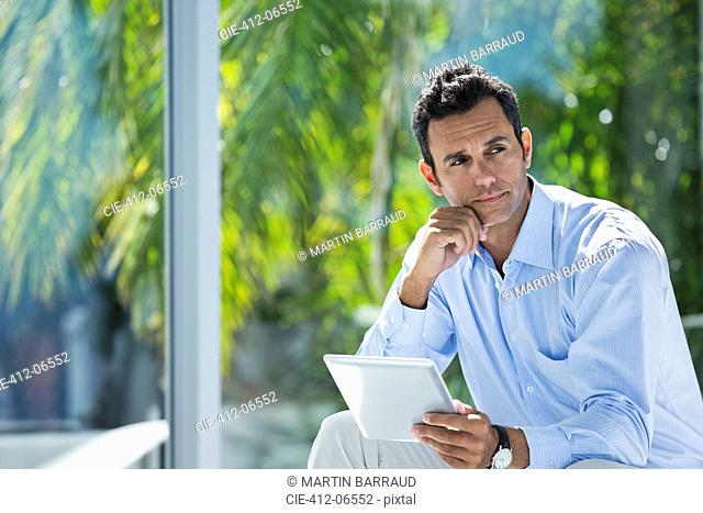 Businessman using tablet computer in office