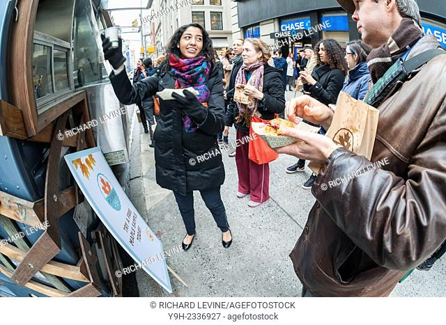 Hordes of foodies queue up at the Snowday truck in New York on Wednesday, December 17, 2014 to celebrate National Maple Syrup Day