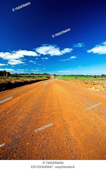 Unsealed road and blue sky in Kangaroo Island, Australia