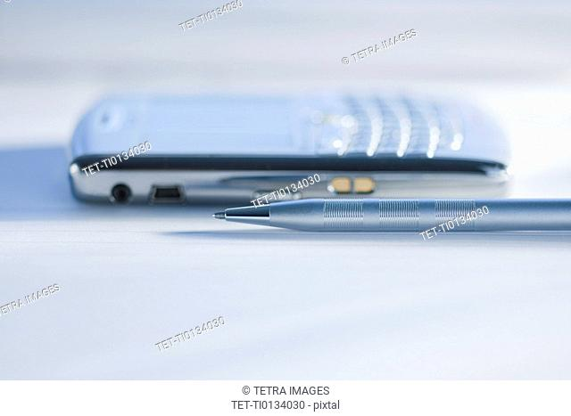 Close up of pen and electronic organizer