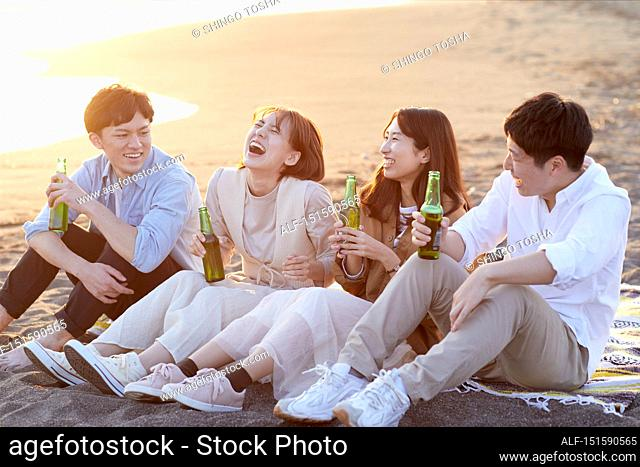 Young Japanese friends at the beach