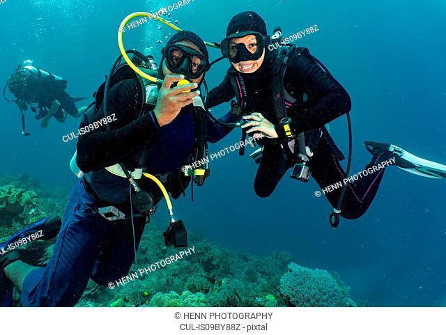 Divers sharing air, Raja Ampat, Sorong, Nusa Tenggara Barat, Indonesia