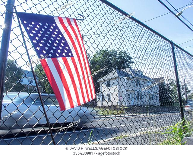 American flag on chainlink fence at the Manton Bend Community Garden in Providence, Rhode Island