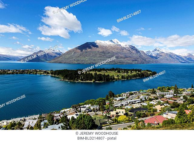 Snowcapped mountains and island in lake, Queenstown, Central Otago, New Zealand
