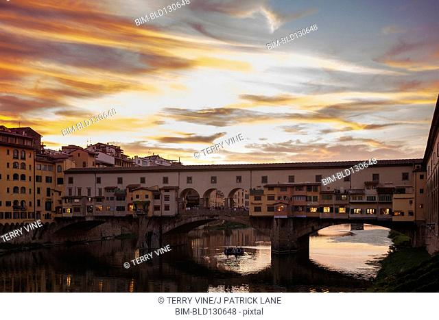 Ponte Vecchio over Arno River at sunset, Florence, Tuscany, Italy